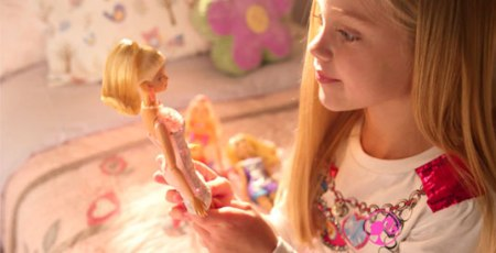 girl-playing-with-barbie